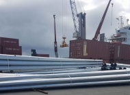 Steel telegraph poles ready for loading onto vessel